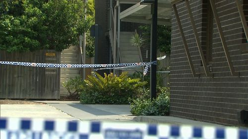 Police have set up a crime scene around the Yeronga apartment where a body was found in a rubbish bin