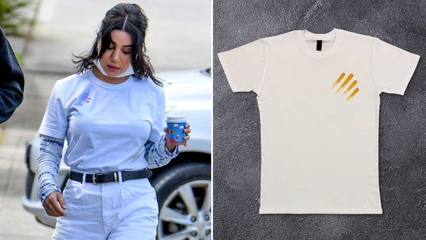 MAFS Martha Kalifatidis spotted wearing Dorito limited edition t-shirt, Doritees, featuring chip-stained finger wipes
