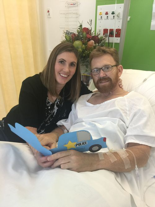 Senior Constable Luke Warburton and his wife Sandra while he was in hospital recovering.