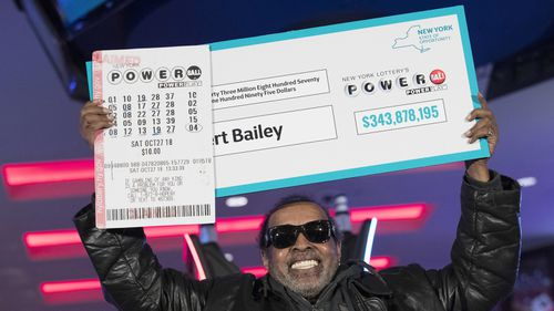 Harlem man Robert Bailey with his prize. New York lottery winners are required to hold a press conference.