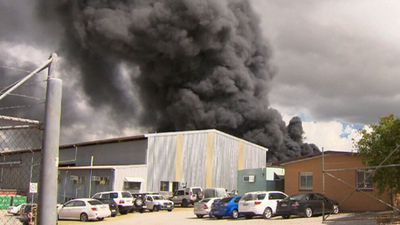 Plumes of black smoke as Brisbane factory goes up in flames