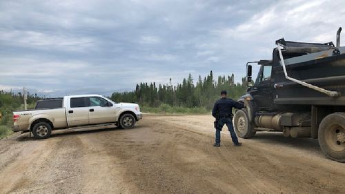 Police checking cars and trucks going in and out of Gillam.