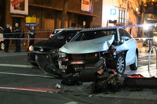 The car crashed into a traffic pole at the intersection of A'Beckett and Queen Streets. Picture: AAP