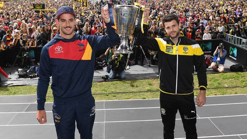 Captains Taylor Walker and Trent Cotchin with the premiership cup. (AAP)