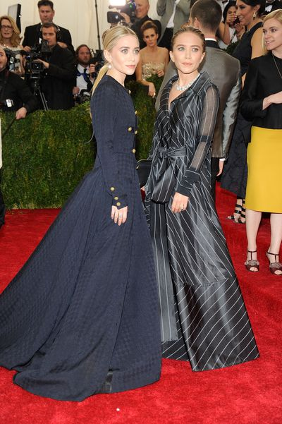 Ashley in vintage Ferre, and Mary Kate Olsen, wearing vintage Chanel, at the Costume Institute Gala at the Metropolitan Museum of Art in New York, May, 2014