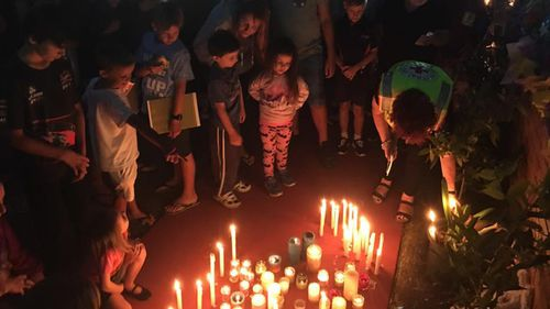 Mourners hold a candlelight vigil for the victims. (Facebook)