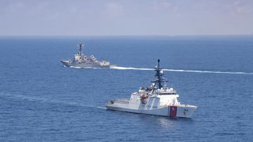 Legend-class U.S. Coast Guard National Security Cutter Munro transits the Taiwan Strait during a routine transit with Arleigh Burke class guided-missile destroyer USS Kidd