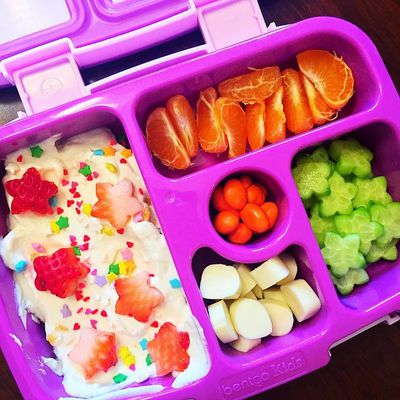 """Aria's bento for today,"" posts Mum, Laura Oakley. ""She now demands a ""special"" lunch everyday. I have created a monster! Yoghurt with strawberry hearts and sprinkles, a cutie, cucumber, string cheese and yogurt dipped raisins."