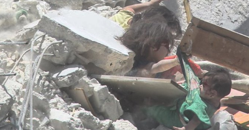 Devastating video has emerged of a young Syrian girl trying to save her baby sister as she lies trapped under rubble after an airstrike on their home town