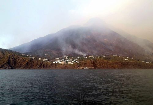 The news agency ANSA says that some 30 tourists jumped into the sea out of fear after a series of volcano erupted on the Sicilian island of Stromboli.