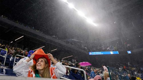 US Open fans are drenched by rainfall as the remnants of Hurricane Ida hit New York.