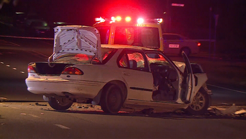 A female passenger has died after a car collides with a truck