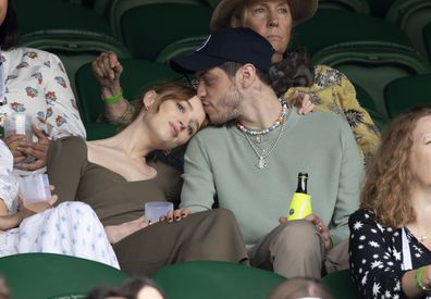 Phoebe Dynevor and Pete Davidson hosted by Lanson attend Day 6 of the Wimbledon Tennis Championships.
