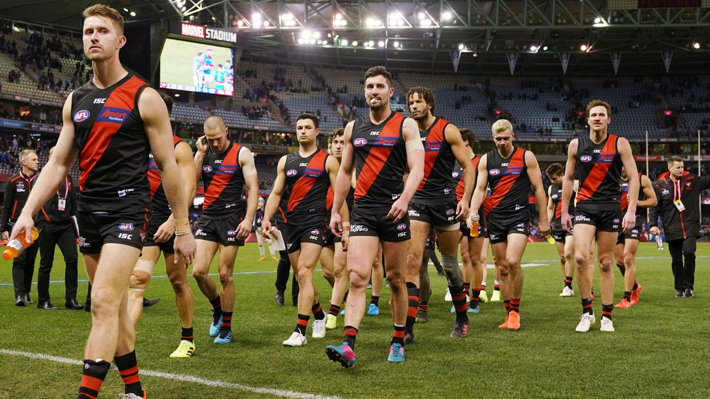 Essendon savaged for 104-point AFL capitulation by Bombers great Matthew Lloyd
