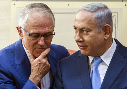 Former Australian Prime Minister Malcolm Turnbull and Israeli Prime Minister Benjamin Netanyahu chat at the opening of an ANZAC museum in the memorial for the fallen in the Battle of Beersheba in 2017.