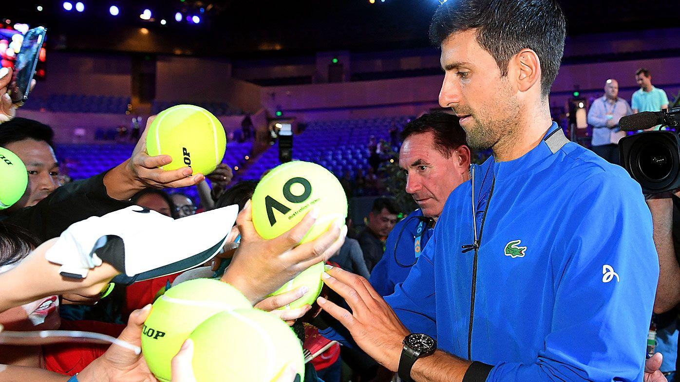 Novak Djokovic signs autographs