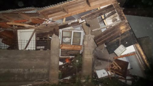 A home destroyed by a tsunami in Los Vilos. (Citizen Corporation National Emergency Network)