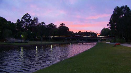 Sunrise over Parramatta, where temperatures are expected to exceed 40 degrees today.