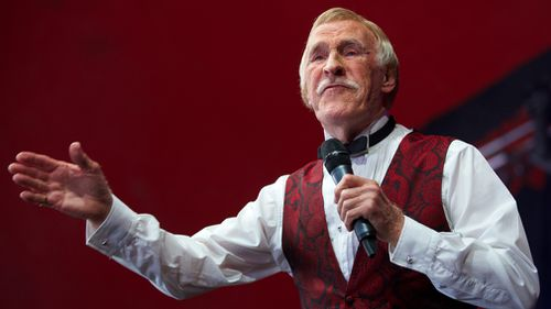 British TV entertainer Bruce Forsyth gesturing to the crowd while performing on the Avalon stage on the fifth day of the Glastonbury Festival of Contemporary Performing Arts in 2013. (AFP)