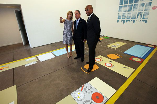 NY mayor Michaell Bloomberg inspects a micro apartment floor plan.