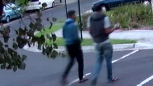 Two men seen in the hours before Mr Wang's death. It is not suggested the men are involved. (Victoria Police)