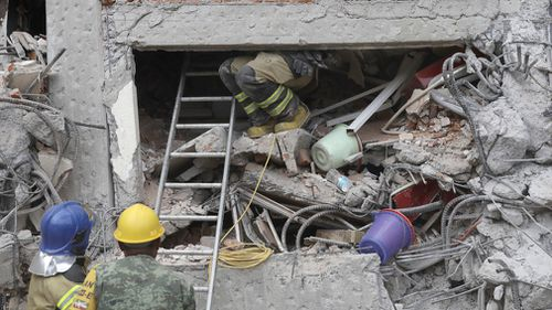 Rescuers search through the rubble for survivors following the Mexico quake.