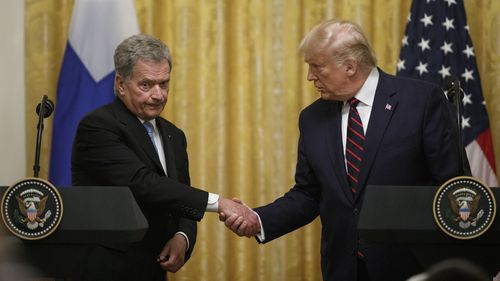 President Donald Trump and Finnish President Sauli Niinisto shake hands during their news conference at the White House.