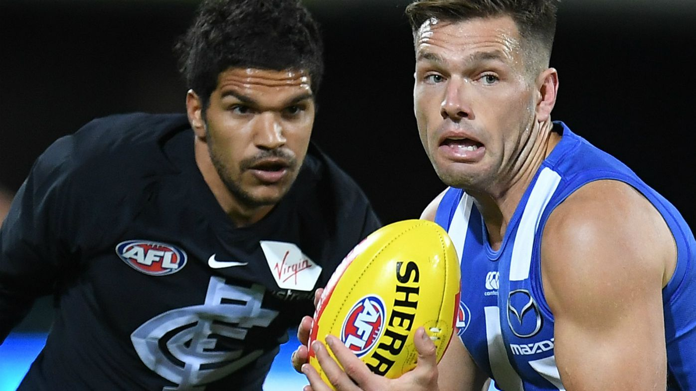 Shaun Higgins of the Kangaroos (right) and Sam Petrevski-Seton of the Blues contest during the Round 4 AFL match between the North Melbourne Kangaroos and the Carlton Blues at Blundstone Arena in Hobart, Saturday, April 14, 2018.
