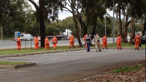 Police and SES personnel search for Daniel Hind at Bolivar today. (9NEWS)