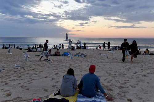 Revellers during the sunrise on New Year's Day at Bondi Beach in Sydney.