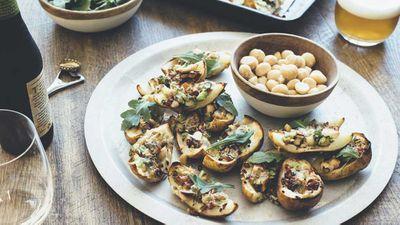 "<a href=""http://kitchen.nine.com.au/2016/10/05/11/30/roasted-potato-skins-with-macadamias-bacon-rocket-and-blue-cheese"" target=""_top"">Roasted potato skins with macadamias, bacon, rocket and blue cheese</a>"