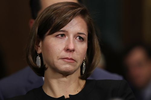 Kavanaugh's wife, Ashley, watches her husband gives evidence that one of their daughters said they should 'pray' for Ms Ford.
