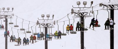 December 22, 2015 - While the north-east of the United States experienced unseasonably warm temperatures throughout December, parts of the west were covered in snow. Here skiers and snowboarders ride a lift at Snoqualmie Pass, Washington. (AAP/Elaine Thompson)