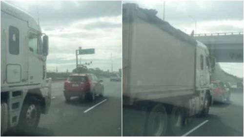 The truck was filmed tail-gating the red vehicle on the Geelong Highway this morning. (Supplied)