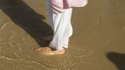 Camilla gets her feet wet. (AAP)