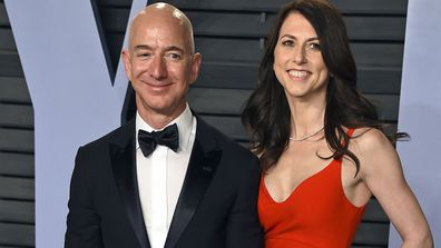 In this March 4, 2018 file photo, Jeff Bezos and wife MacKenzie Bezos arrive at the Vanity Fair Oscar Party in Beverly Hills, California.