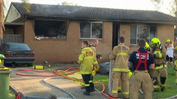 'Super mum' rescues five kids from burning home