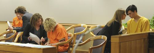 From left, Kayden McIntosh, 16, Denali Brehmer, 18, and Caleb Leyland, 19, are arraigned by a Superior court judge in the Nesbett Courthouse in Anchorage, Alaska. Photo by Bill Roth/Anchorage Daily News/TNS/Sipa USA.