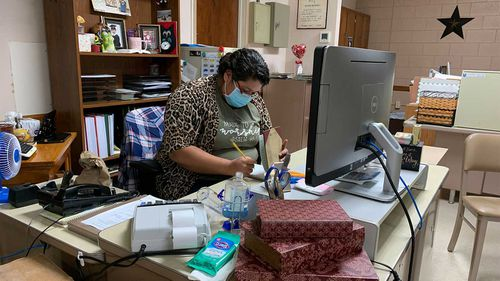 Vicky Zapata, who works for the city, has helped lead prayer vigils for COVID-19 victims and organise food deliveries for those in quarantine.
