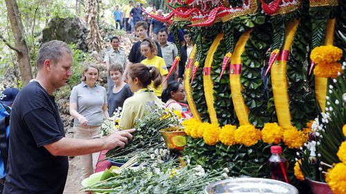 Australian doctor and diver Richard Harris pays respect to goddess Nang Non before entering Tham Luang cave in Mae Sai district, Chiang Rai province, Thailand.