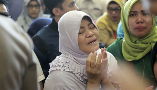 Stricken relatives are arriving at Indonesia's National Search and Rescue Agency headquarters in Jakarta for word of their loved ones on the Lion Air plane.