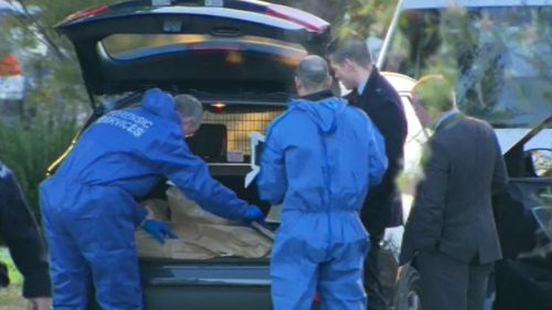 Forensic officer at the scene.