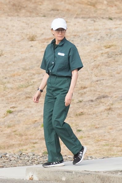 Felicity Huffman seen in green prison scrubs while carrying out her sentence for her involvement in the college admissions scandal at the Federal Correctional Institution (FCI) in Dublin, Northern California