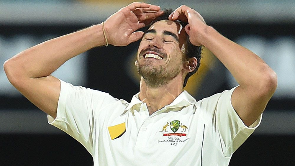 Mitchell Starc had a chance put down by Steve Smith off his bowling. (AAP)