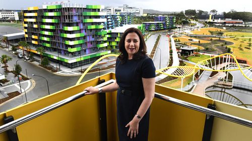 Queensland Premier Annastacia Palaszczuk is seen inspecting an apartment balcony following the formal handover of the Parklands Development to the Gold Coast 2018 Commonwealth Games Corporation at Southport on the Gold Coast. (AAP)