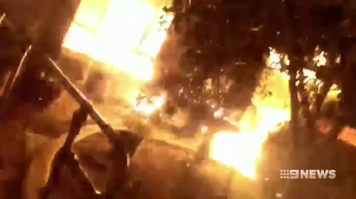 A neighbour filmed the blaze with his phone as he ran to see if anyone was inside.