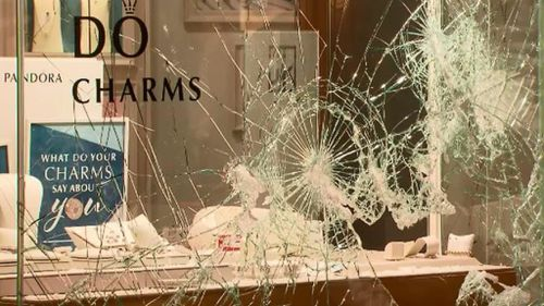 The thieves used hammers and an axe to smash the window of the store. (9NEWS)
