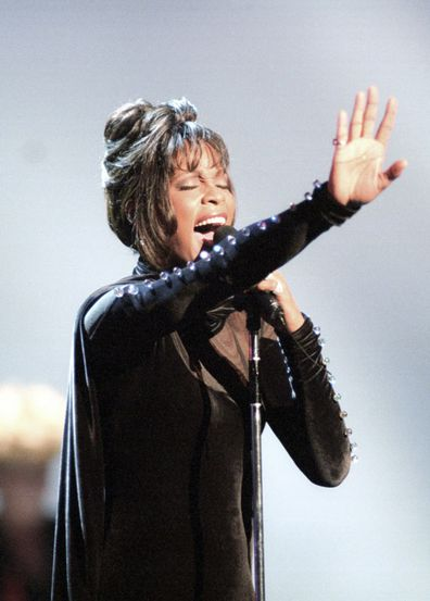Whitney Houston performs during the 21st American Music Awards at the Shrine Auditorium in Los Angeles on Feb. 7, 1994