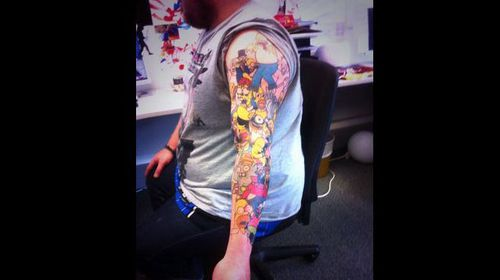 Mr Weir has a total 41 tattoos of Homer Simpson on his left arm. (Twitter)