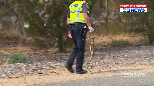 The second man, a 38-year-old was charged over the discovery of a large crossbow found in the boot of his car. (9NEWS)